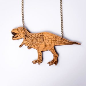 cherry wood t rex statement necklace with skeleton etched design