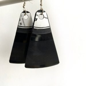 pair of black dangly earrings made from vinyl records