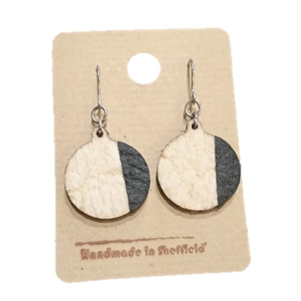 round dangly earrings in cream and black made with vegan friendly pinatex