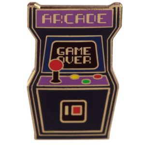 black and purple enamel pin badge in the shape of a retro arcade game